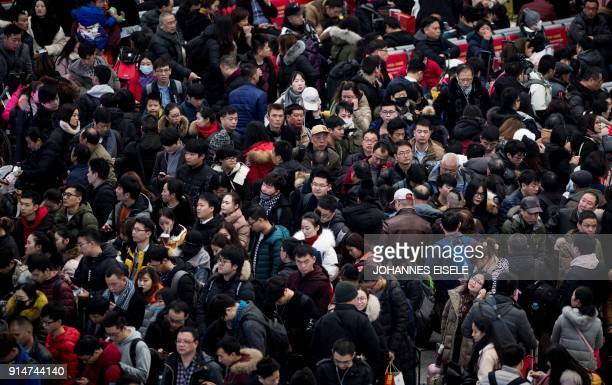 Passengers gather in the waiting hall at Hongqiao Railway Station ahead of the Lunar New Year holidays in Shanghai on February 6 2018 China's...