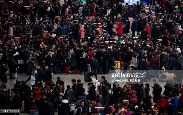 TOPSHOT Passengers gather in the waiting hall at Hongqiao Railway Station ahead of the Lunar New Year holidays in Shanghai on February 6 2018 China's...