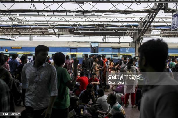 Passengers gather on a platform at the Bhubaneshwar Railway Station after Cyclone Fani passes in Bhubaneshwar Odisha India on Sunday May 5 2019...