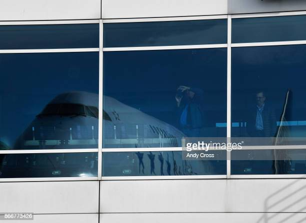 Passengers get a look and take pictures of the iconic Boeing 747 parked at the United's Bconcourse at Denver International Airport October 26 2017...