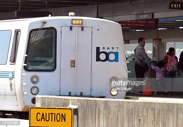 Passengers get off of a Bay Area Rapid Transit train as it arrives at the Daly City station on August 15 2011 in Daly City California The hacker...
