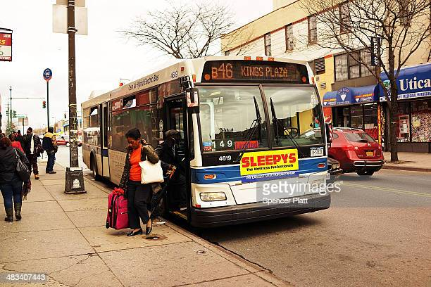 Passengers get off of the B46 bus on April 8 2014 in the Brooklyn borough of New York City The B46 bus which runs through parts of Crown Heights...