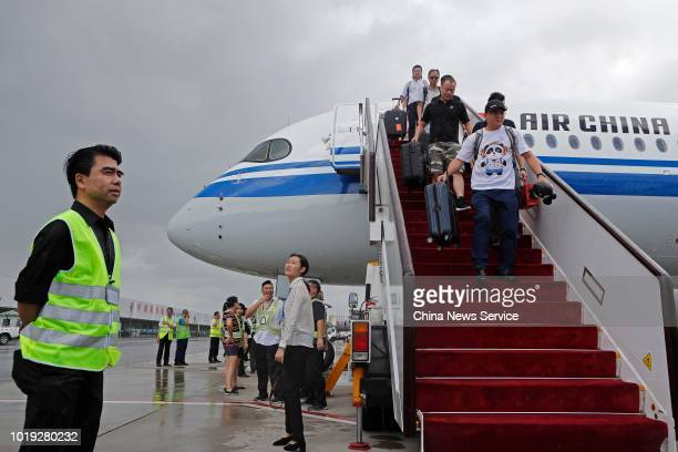 Passengers get off the Airbus A350900 of Air China after its maiden flight at Shanghai Hongqiao International Airport on August 14 2018 in Shanghai...