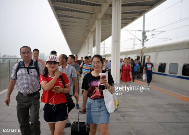 Passengers get off the first high speed train D6655 at Baiyangdian Railway Station in Xiongan New Area on July 6 2017 in Baoding Hebei Province of...