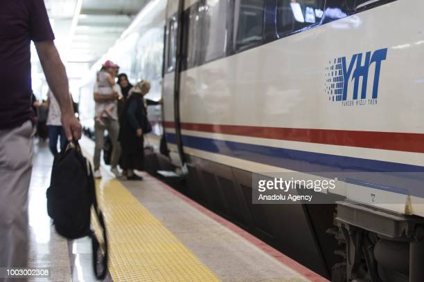 Passengers get on a high speed train at a train station in Ankara Turkey on July 19 2018