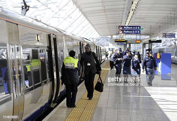 Passengers get on the Gautrain Africa's first highspeed rail line on August 2 2011 in Pretoria South Africa's first highspeed train made today its...