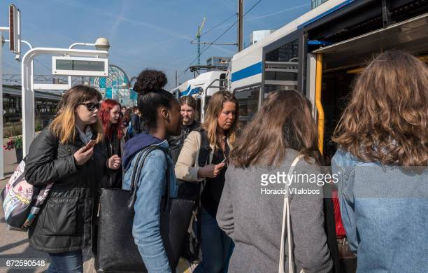Passengers get onto a train at Amsterdam South Metro station on April 20 2017 in Amsterdam Netherlands The city's Metro system was first introduced...