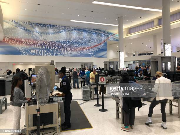 Passengers go through TSA control check at Baltimore International Airport in Maryland on November 30 2019