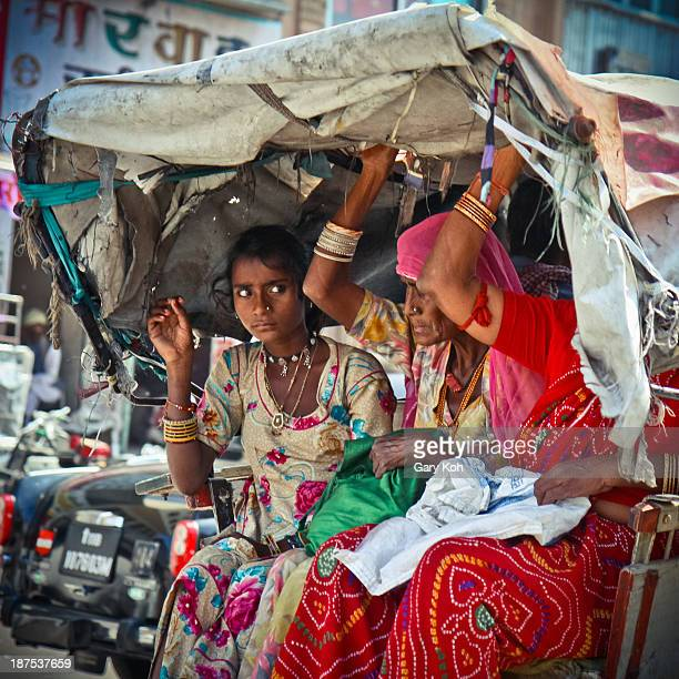 CONTENT] Passengers hang on as their rickshaw navigates a bumpy road near a market in Jodhpur India Jodhpur is the second largest city in the Indian...