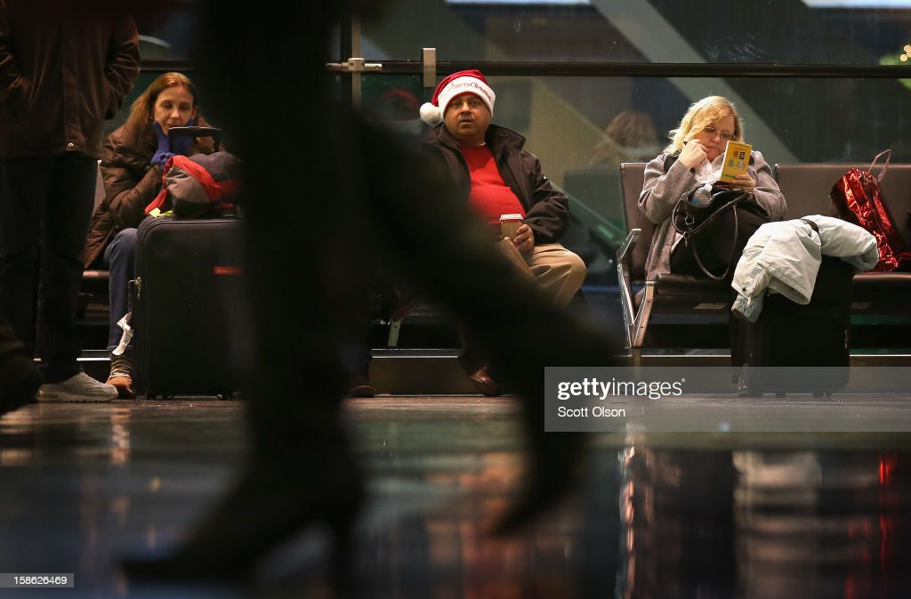 Passengers hang out at O'Hare International Airport on December 21, 2012 in Chicago, Illinois. Today, the busiest air travel day of the Christmas holiday, an estimated 200,000 travelers are expected to travel through O'Hare Airport.