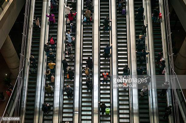 TOPSHOT Passengers head back to their hometowns for the 'Spring Festival' or Lunar New Year from Beijing West Railway Station in Beijing on January...