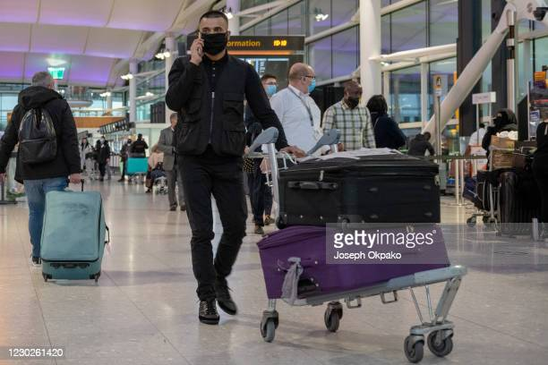 Passengers heading to the departure gates at Heathrow's Terminal 2 on December 22, 2020 in London, England. London and the South East have entered a...