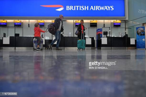 Passengers hoping to catch a rare flight are seen in a neardeserted departure area at Heathrow airport Terminal 5 in west London on September 9 as...