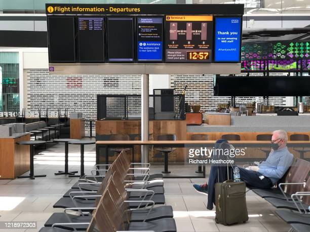 Passengers in a quiet Terminal 5 departure lounge at Heathrow Airport on April 15, 2020 in London, United Kingdom. The airport expects 90% fewer...