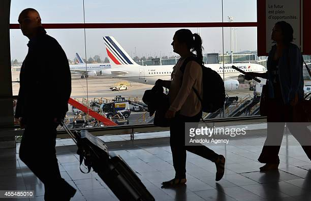 Passengers in Air France's checkin lounge after Air France cancels 60 percent of scheduled flights due to pilot's strike for the duration of a week...