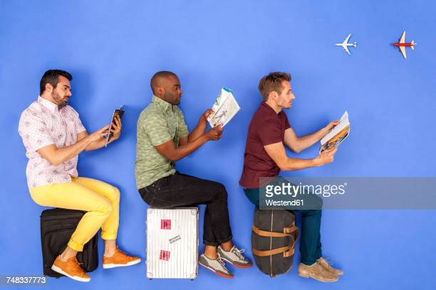 Passengers in airplane reading magazines