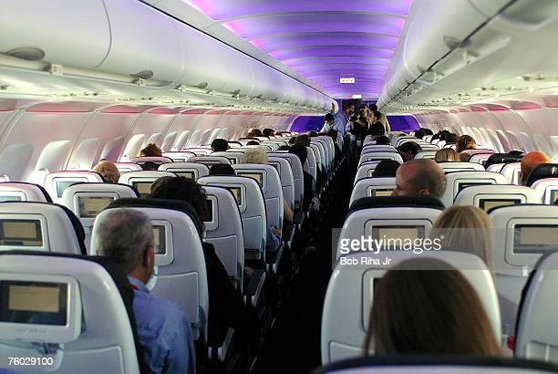 Passengers in customdesigned leather chairs enjoy Virgin America airlines moodlit cabins and inflight entertainment system which includes ondemand...