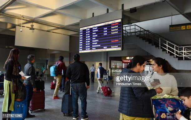 Passengers in front of the schedule board at Terminal 2 Indira Gandhi International Airport after the air space restrictions following tensions...