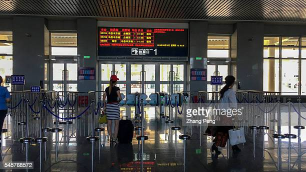 Passengers in Hami railway station waiting for the CRH train from Hami to Xining in Qinghai Province The LanzhouXinjiang HighSpeed Railway also known...