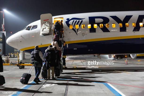 Passengers in protective face masks are seen embarking Ryanair flight at Krakow Balice Airport as many International flights are canceled due to the...