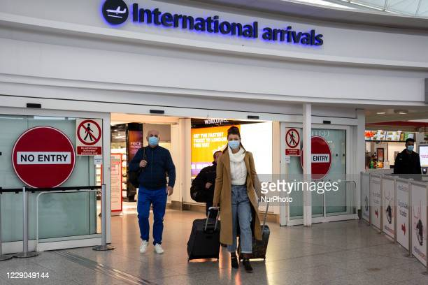 Passengers in protective face masks are seen on London Stansted Airport as the United Kingdom is trying to take control over second wave of Covid-19...