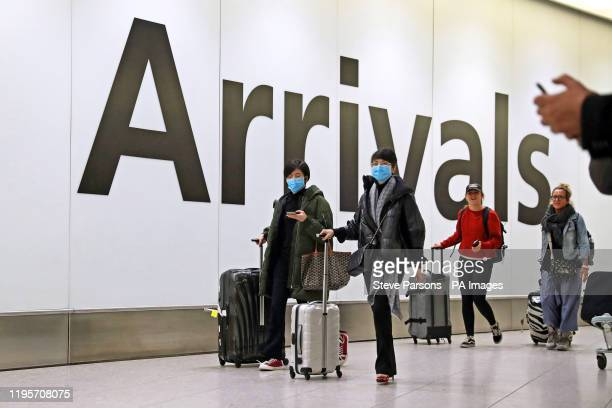 Passengers in the arrivals concourse at Heathrow Terminal 4 London as the Government's Cobra committee is meeting in Downing Street to discuss the...