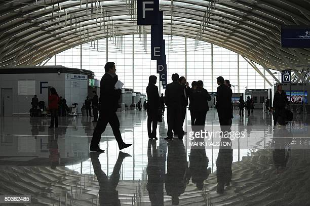 Passengers in the main departures hall of the new terminal two at the Pudong International Airport in Shanghai on March 26 2008 The new terminal is...