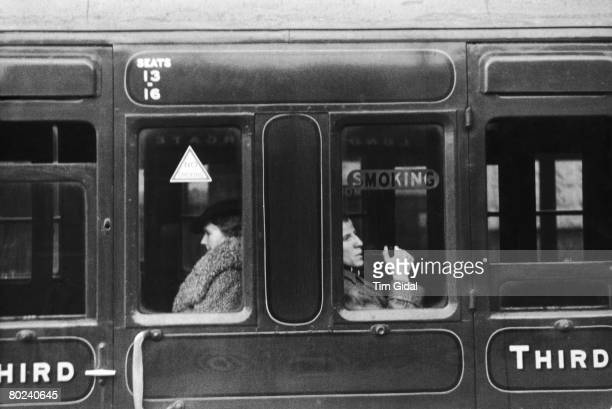 Passengers in the smoking and nonsmoking compartments of a train at London's Victoria Station 11th February 1939 Original Publication Picture Post...