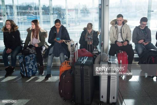 Passengers in the terminal at Stansted Airport where up to 300 people had to spend the night after snow and ice forced dozens of Ryanair and easyJet...