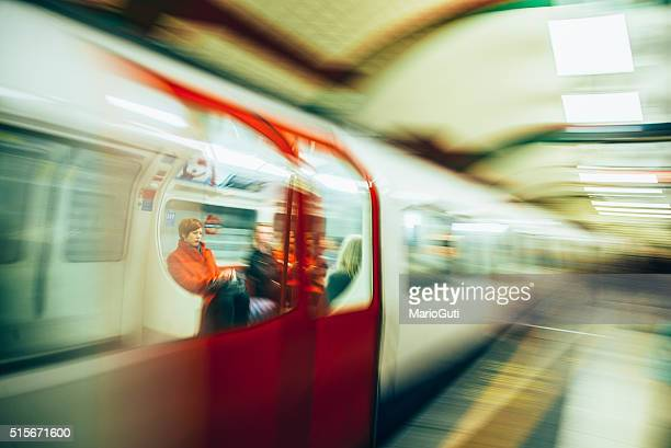 Passengers inside a London underground train.
