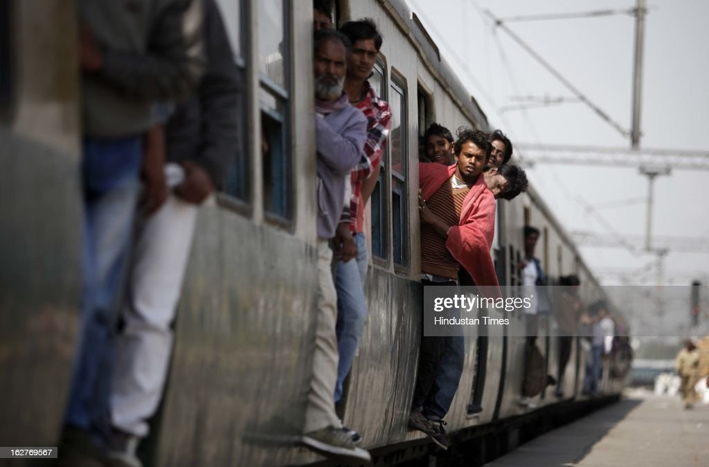 Passengers inside an overcrowded train at Nizamuddin railway station on February 26, 2013 in New Delhi, India. Indian Railway Minister Pawan Kumar Bansal presented his maiden Railway budget for the next fiscal year in the parliament.