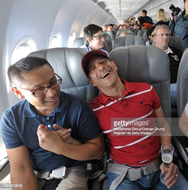 USA Passengers Jordan Scheinfeldt left Mark Hermogeno laugh as they listen to comedian and 'air hostess' Pam Ann over the PA system during JetBlue's...