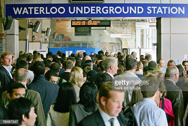 Passengers jostle to enter the Underground station at Waterloo Station in central London 04 September 2007 as commuters battled with severe transport...