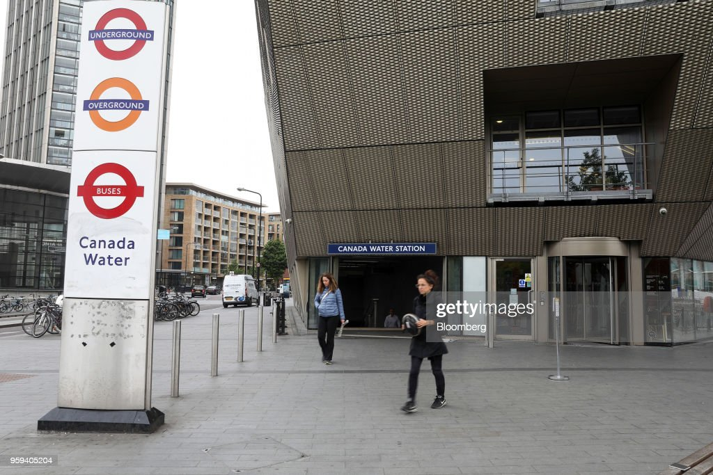 Passengers leave Canada Water station in London, U.K., on Wednesday, May 16, 2018. British Land Co. will seek approval to develop as many as 3,000 homes and work space equivalent to almost four Gherkin skyscrapers on a plot in south Londons Canada Water. Photographer: Chris Ratcliffe/Bloomberg via Getty Images