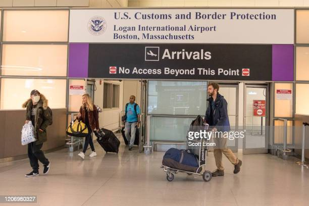 Passengers leave the secure area in the arrivals area of the international terminal at Logan Airport on March 13, 2020 in Boston, Massachusetts. The...