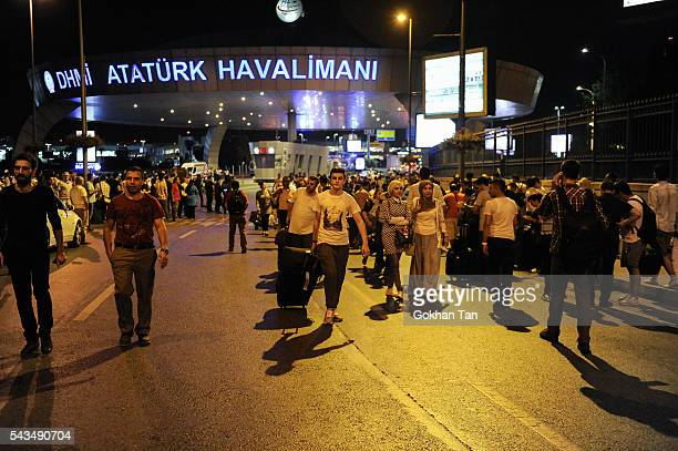 Passengers leave the Turkey's largest airport Istanbul Ataturk after the suicide bomb attacks June 28 Turkey Three suicide bombers opened fire before...