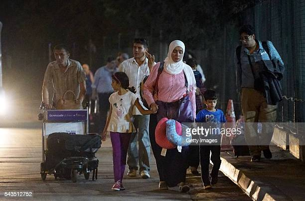 Passengers leave the Turkey's largest airport Istanbul Ataturk after the suicide bomb attack in the early hours of June 29 Turkey Three suicide...