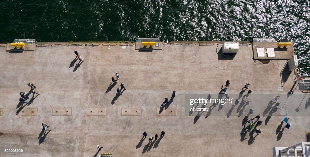 Passengers leaving a ship : Stock Photo