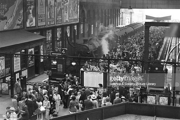 Passengers leaving a train at Liverpool Street station at 9.00 am on 29 June 1949. This station was the busiest terminus in London at this time....