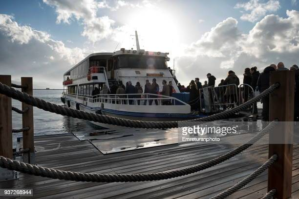 passengers leaving ferry at the station,izmir. - emreturanphoto stock pictures, royalty-free photos & images