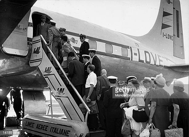 Passengers leaving for New York crowd the ramp of the plane of the airline 'LAI' Ciampino 1950s