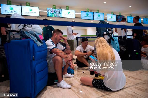 Passengers left stranded after the collapse of British travel firm Thomas Cook remain at Punta Cana's international airport in the Dominican Republic...
