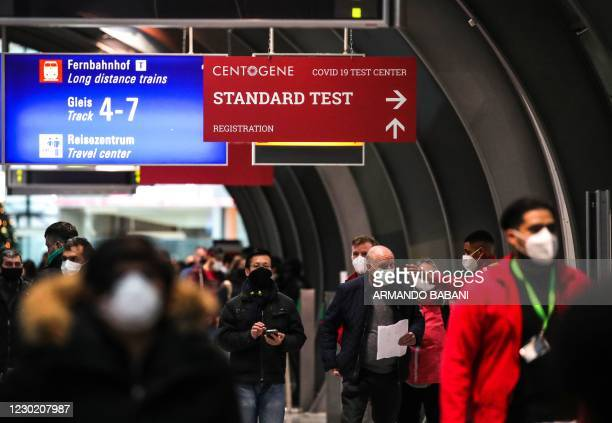 Passengers line up at a Covid-19 test centre at Frankfurt International Airport in Frankfurt am Main, western Germany, on December 19, 2020. -...
