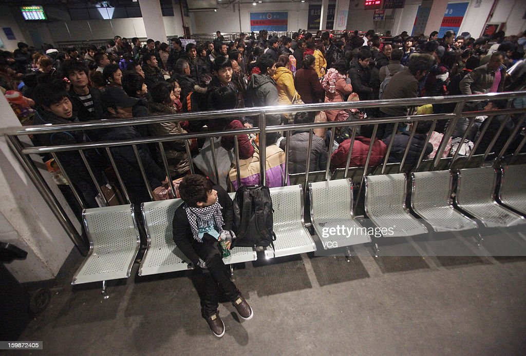 Passengers line up to board a train at Ningbo East Railway Station on January 22, 2013 in Ningbo, China. China's annual Spring Festival travel rush will start on January 26 as authorities estimate 3.4 billion passenger journeys will be made for the Chinese lunar new year during the 40-day travel period.