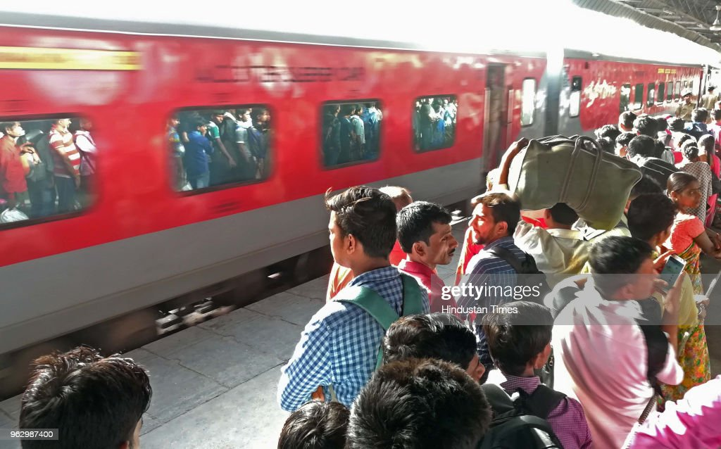 Passengers Line Up To Enter In General Class Compartment Of Sampoorna Kranti Express