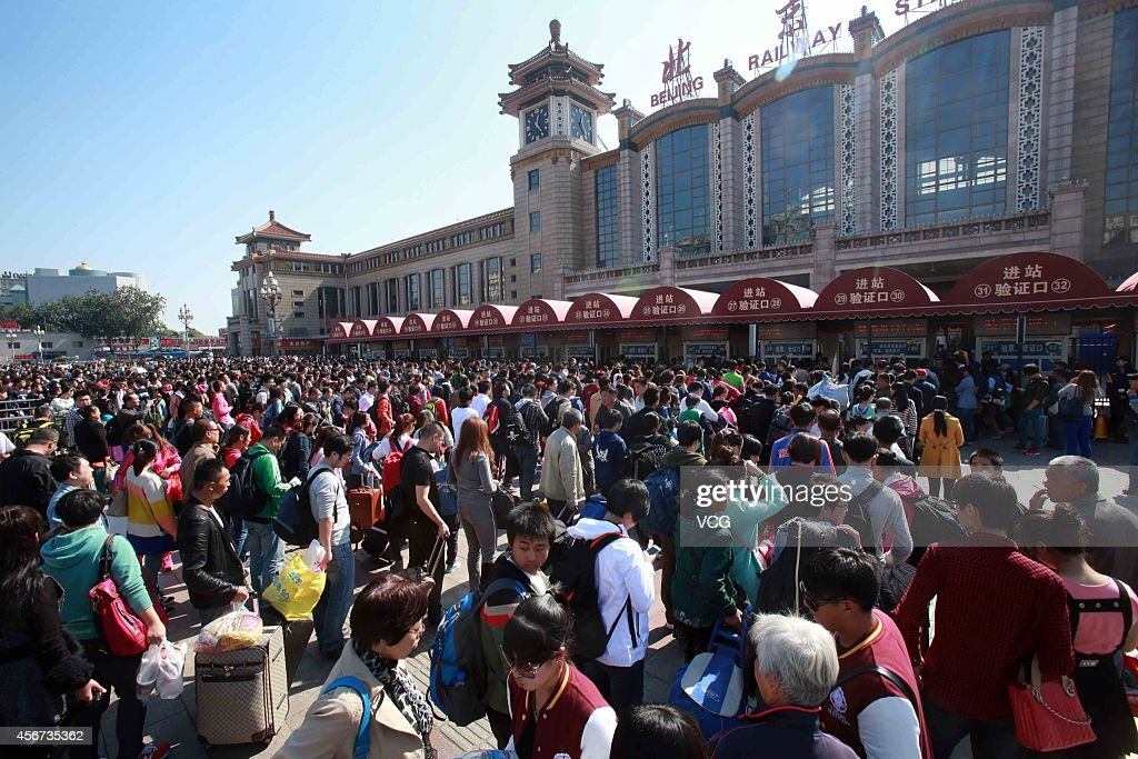 Passengers line up to enter the Beijing Railway Station on the sixth day of the National Day holiday on October 6, 2014 in Beijing, China. China's golden-week National Day holiday is expected to bring a tourism peak throughout the country.