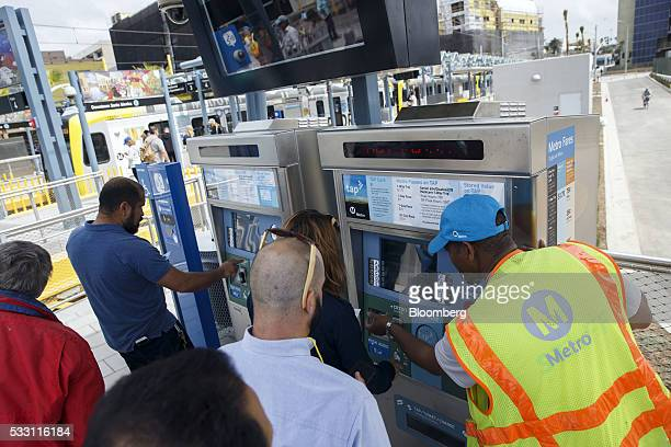 Passengers load TAP fare cards at the Metro Expo Line light rail station in Santa Monica California US on Friday May 20 2016 The extension opened...