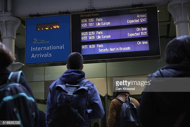Passengers look at a sign indicating disruption on the Eurostar at St Pancras Station on March 22 2016 in London England Journeys to Brussels were...