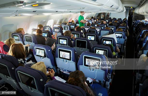 New York United States of America February 23 Passengers look at TV screens in Economy Class section in a plane on February 23 2016 in Berlin Germany