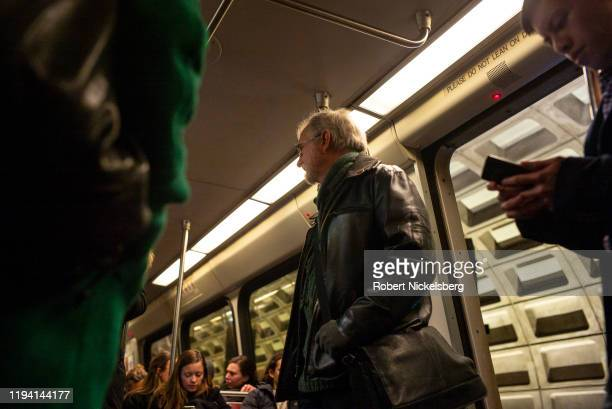 Passengers look for a seat onboard a Metro car in Washington, DC, December 12, 2019. The Washington Metro opened in 1976 and carries approximately...